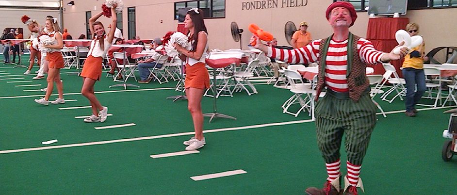 Bonzo the Clown cheering with the University of Texas cheerleaders.