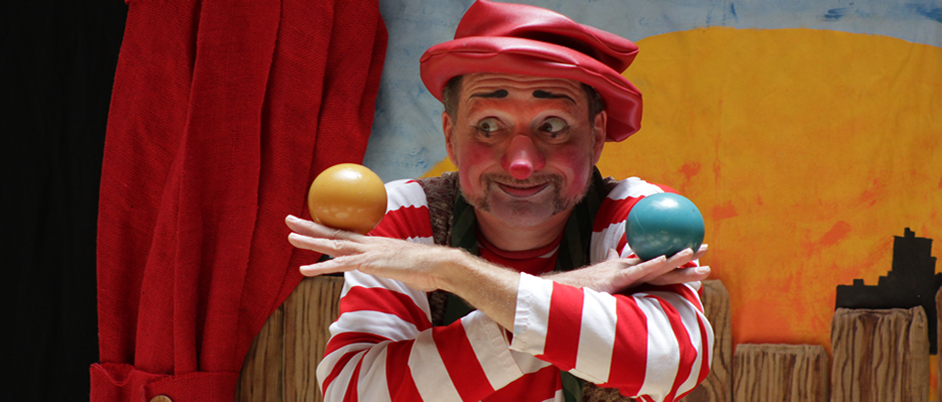 Bonzo the Clown juggling colorful balls.